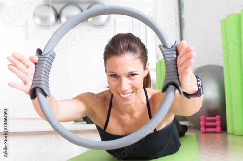 Tuinposter Gymnastiek girl doing pilates with ring