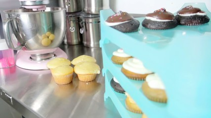 color set of cupcakes on a stand