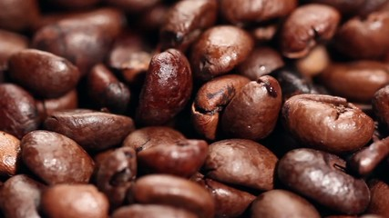 Close up roasted coffee beans,rotating