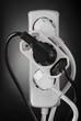 Leinwandbild Motiv Strom Multistecker Deutsch schwarz weiß