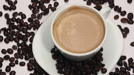 Coffee cup and beans on a white background,rotating
