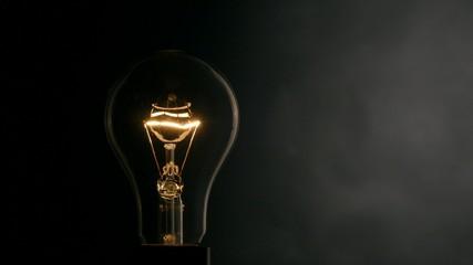 Light bulb over black background