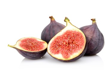 Four sliced figs isolated on white background