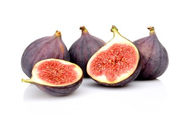 Group sliced figs isolated on white background