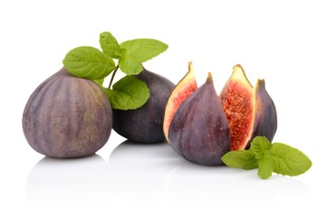 Three figs with mint,split like flower isolated on white backgro