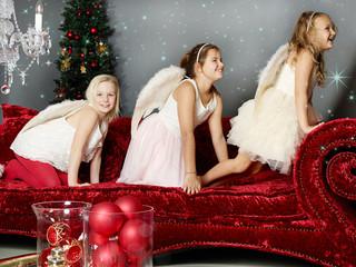 Three girls wait for Christmas Eve