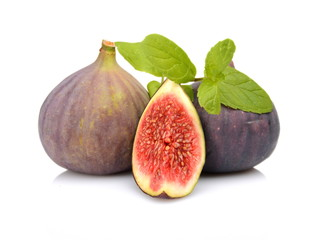 Three sliced figs with mint isolated on white background