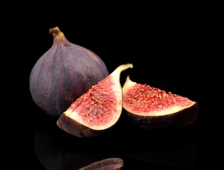 Quarters of figs isolated on black background