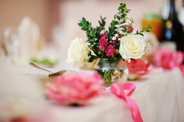 bouquet of flowers in a vase on the table. Wedding decor