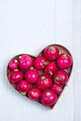 fresh radish  in heart shape
