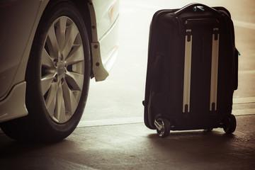 suitcase near a taxi