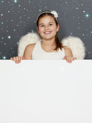 Cute girl with whiteboard for christmas