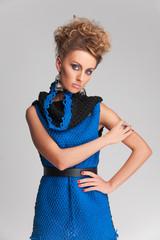 beautiful blonde woman wearing blue dress.