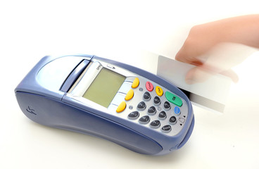 EFTPOS machine with a credit card being swiped.