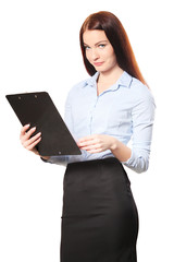 A successful young businesswoman with a clipboard, isolated on w