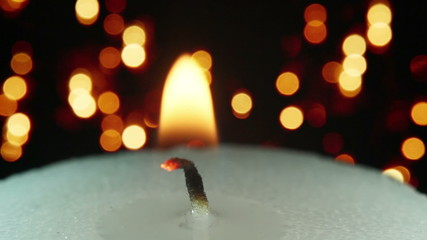 burning candle and christmas lights bokeh loopable