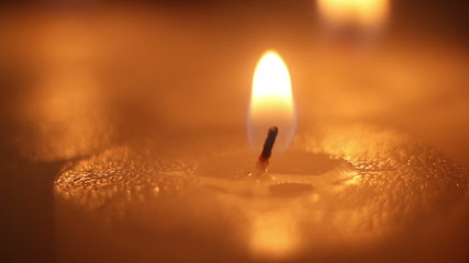 lighting candle by matchstick close-up