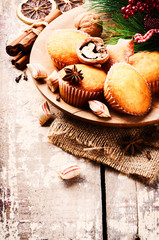 Christmas setting with cupcakes and winter spices