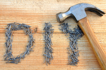 DIY (do it yourself) text from small nails and hammer