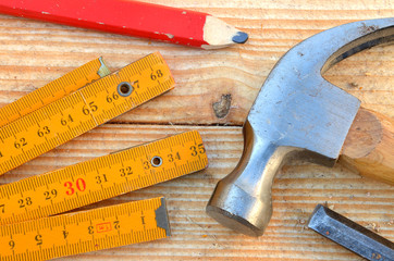 Claw hammer, carpenter meter, pencil and chisel