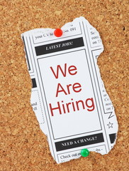 We Are Hiring in the classified adverts section of the newspaper