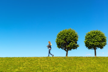 Young woman walking on the beautiful hill