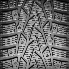 Car tire tread background closeup.
