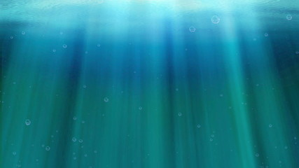 Ocean waves underwater with light rays