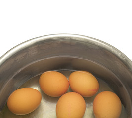 hen eggs  in metal pot  isolated on white background