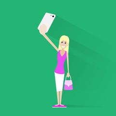 girl taking selfie photo on smart phone over green