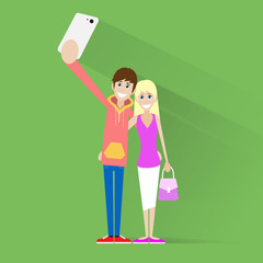 couple taking selfie photo on smart phone over green
