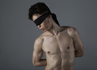 Young man  with a blindfold