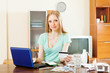 Blonde long-haired girl buying medication in online pharmacy