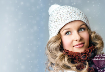 Cheerful woman clothing in warm hat. Winter season.