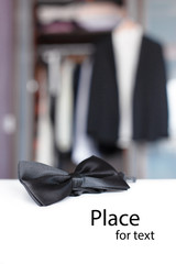 Bow tie. Open closet and tuxedo.