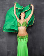 Young pretty woman in green indian dress