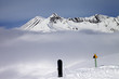 Warning sing, snowboard on off-piste and mountains in fog