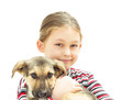 Happy smiling kid is holding a puppy on a white background isola