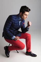 fashion man sitting on a stool, thinking