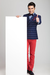 fashion man showing the thumbs up sign