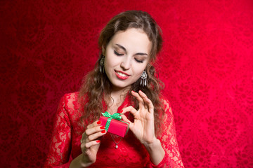 Portrait of beautiful girl holding a small gift