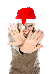Girl in Santa hat showing hands stop