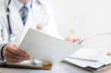 Doctor reading medical notes