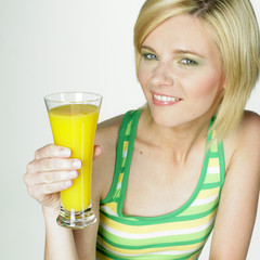 woman with a glass of juice