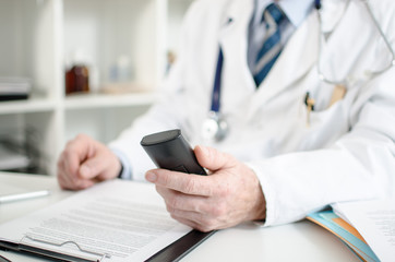 Doctor holding a phone