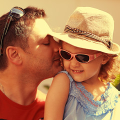 Happiness. Father kissing his daughter outdoors summer