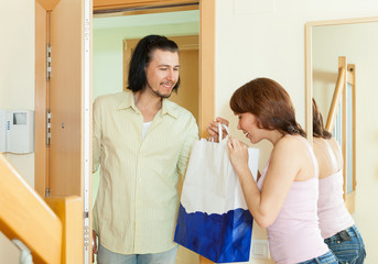 Man coming a woman with gift