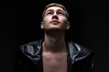 Photo of the young man looking up