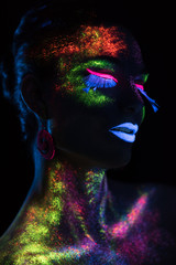 Sensual woman in fluorescent paint makeup