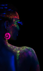 Back of woman in fluorescent paint makeup